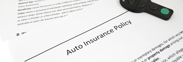 What factors contribute to auto insurance rates?